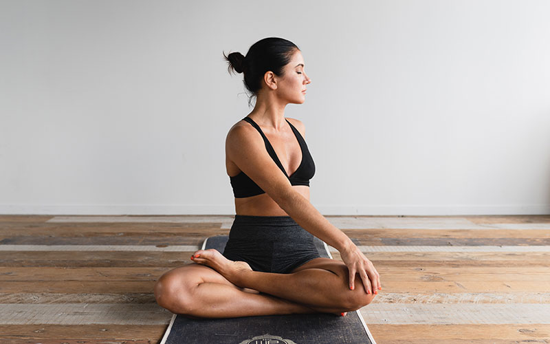 Woman in sitting yoga position